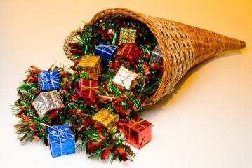 A cornucopia filled with holidat Christmas presents.