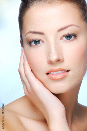 Portrait of young adult  woman with health skin of face.