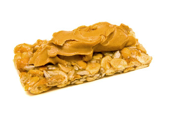 A healthy snack of peanut butter on a granola bar