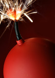 Red bomb with burning fuse close-up poster