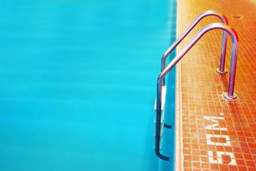 Pool Ladder with orange tiles