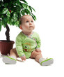 Baby sitting under green tree, isolated