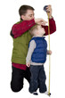 Father measuring son with a measuring tape