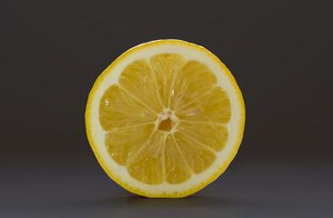 Sliced lemon isolated on a dark background