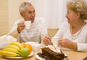 Elderly couple drink tea