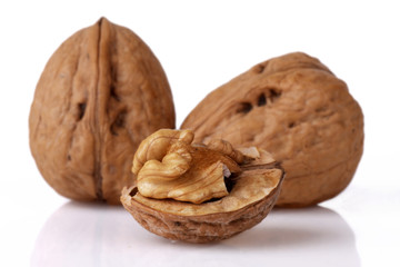 Close-up of a walnut against white background