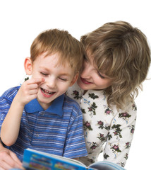 Happy son with mother read the book