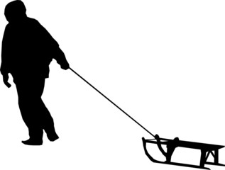 Silhouette of man pulling sledge