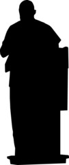 Silhouette of speaker on podium at conference