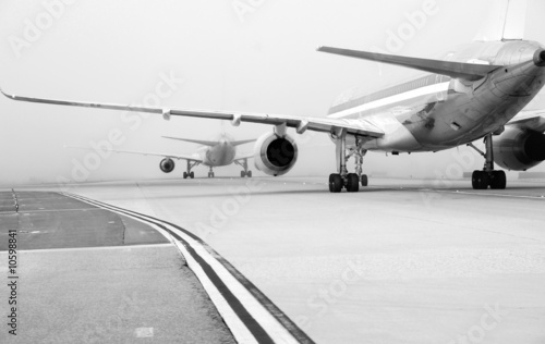 Planes on foggy runway