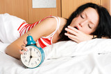 Fototapety young woman waking up and yawning in the morning