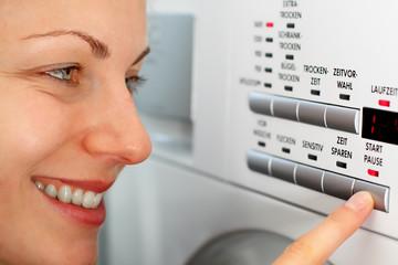 happy maid doing laundry