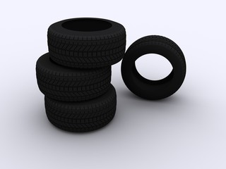 a stack of four car tyres