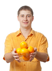 man with orange fruits in hands