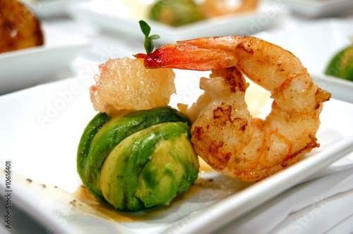 Avocado ball stuffed with pink shrimp fried basmati rice