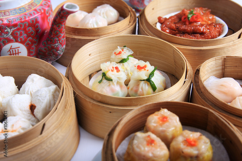 Poster variety of dim sum in bamboo steam containers