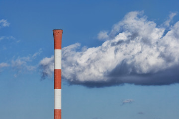 Chimney on a background cloudy sky