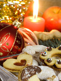 Christmas atmosphere - candle, sweets and Christmas decorations poster
