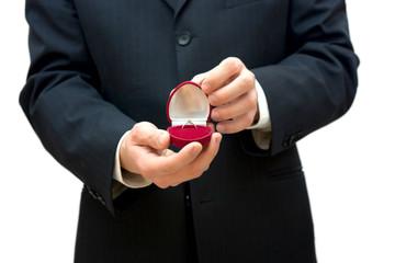 man holding box with wedding ring
