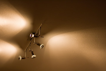 Spot lights shining on the ceiling