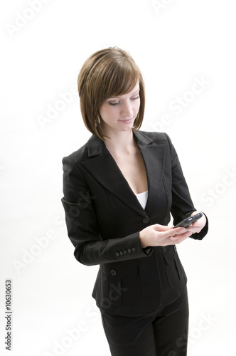 Attractive Business Women Using a PDA