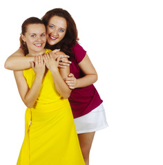 two girls smile and are embraced