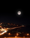 moon over night roads and embankment poster