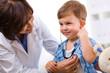 Doctor examining child - 10651289