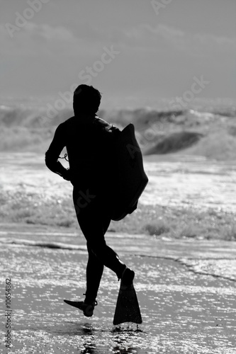 Bodyboard surfer running