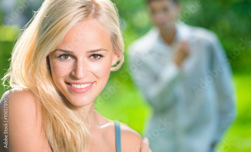 Young woman and looking at woman man on background