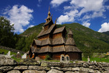 Picturesque landscape with the Borgund stave church in Norway poster