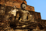 Statue of a sitting deity in historical park Sukhothai. poster