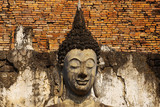 Statue of a deity in historical park Sukhothai. poster