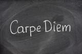 Carpe Diem phrase on blackboard poster