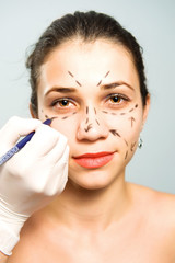 Marking face for cosmetic surgery