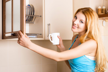beautiful woman with a cup in the kitchen