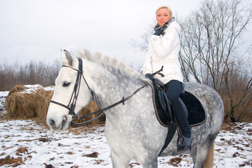 Girl on a horse.winter