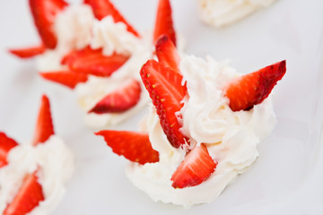 Slices of a strawberry with whipped cream