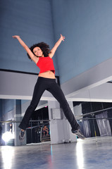 young woman jumping indoor