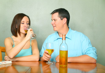Man And Woman Talking While Enjoying Wine