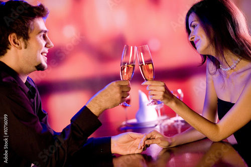 Young couple celebrating with champagne together