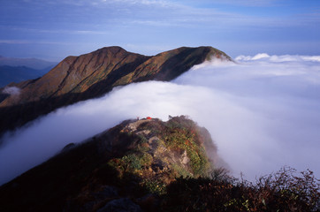 Sea of clouds fell in torrents.