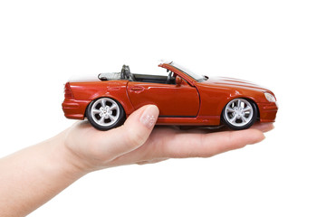 Woman hand with holding red sports car