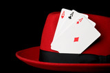 Three aces on felt hat, isoalted on black; concept for gambling poster