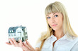 beauty blonde woman with little house on hand