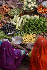 Indian ladies selling fruit and veg at a street market