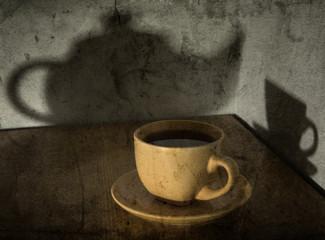 Grunge still-life with a tea cup