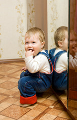 Small smiling baby playing with mirror #2