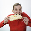 Woman eating gruyere