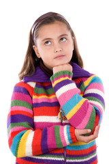 Adorable girl with woollen jacket thinking